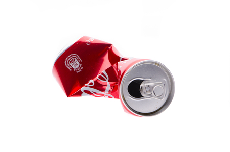 Crumpled metal can on a white isolated background Stock Photo