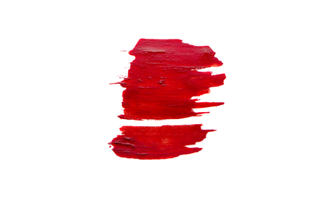 Smear of red paint on white background