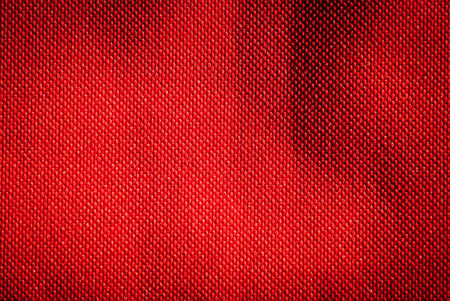 red scarf: Red fabric background pattern and texture.