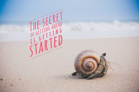 Inspirational quote by unknown source on Hermit crab walking along beach with waving sea blurry background with faded film, grain, soft effect.