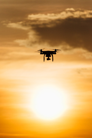 A drone fly over sunset with warm color in siloutte scene Standard-Bild