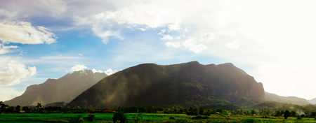 Vintage scene of cloud and mountain ridge in oldie color grading feel like nostagic over rural countryside of Thailand