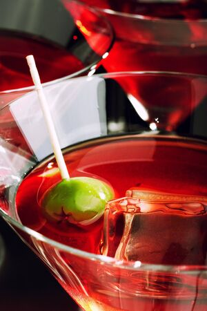 Martini glasses with olive and ice Stock Photo