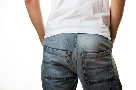 Man in jeans in back Stock Photo