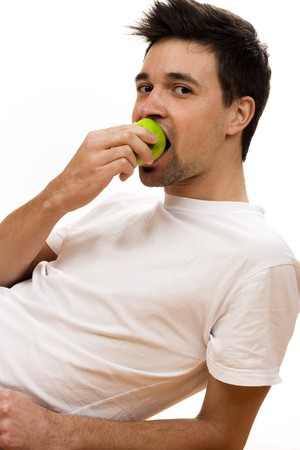Man eating green apple Stock Photo - 4118762