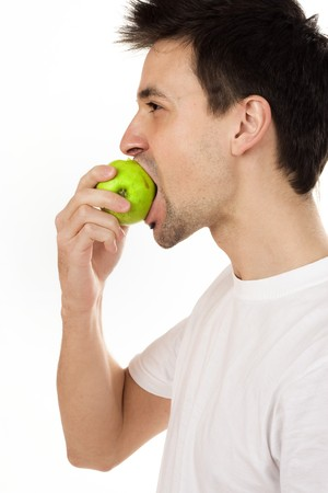 Man eating green apple Stock Photo