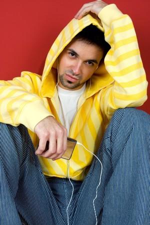Young man listen music Stock Photo - 4118859