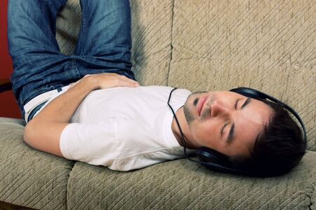 Laying young man listening music