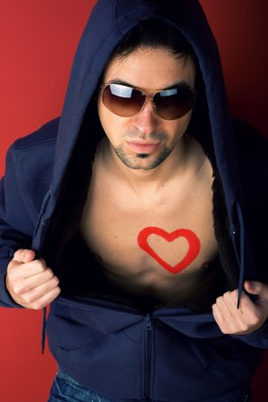 Man chest with heart painted with eye-glasses photo