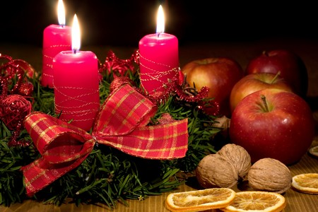 Christmas backgrounds - Christmas wreath with candle and apple Stock Photo