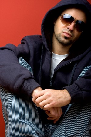 Fashion Shot of a Young Man A trendy European man dressed in contemporary cloth with eye-glasses. photo