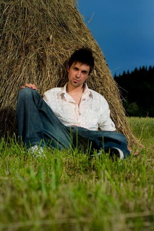 Young Man relaxing on the hay photo