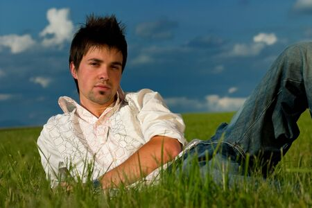 Young man in grass photo