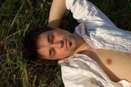 Young Man relaxing on the grass photo