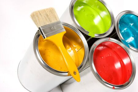 Opened paint buckets colors with paintbrush