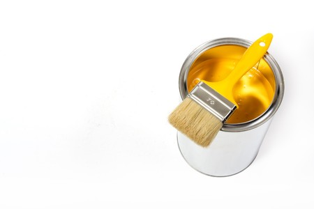 Yellow paint can with brush isolated on a white background - with path