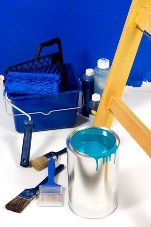Blue painting with ladder, roller brush, bucket and red pigments