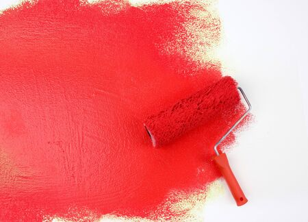 paintroller: Red paint roller Stock Photo
