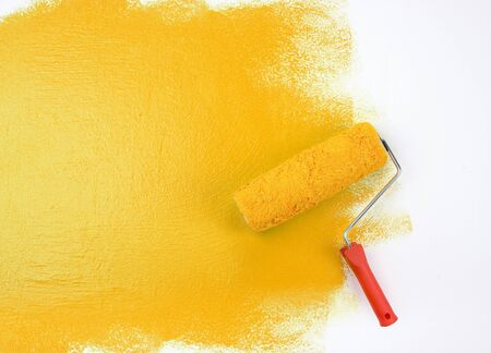 Yellow paint roller Stock Photo