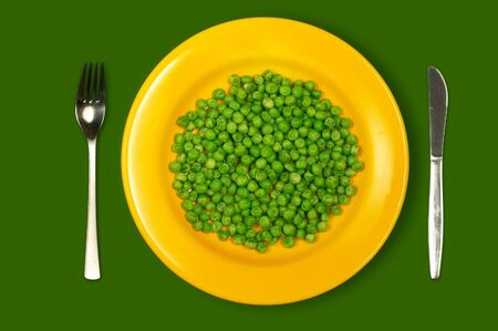 dietology: Green peas on yellow plate
