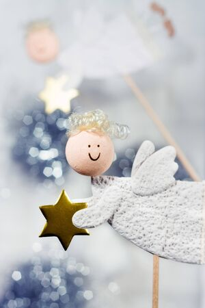 Angels with golden star - Christmas decoration Stock Photo