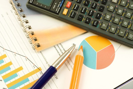 Close-up of a pen, line graph and calculator Stock Photo