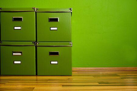 Four Green boxes on Parquet Floor Stock Photo