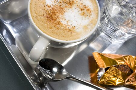 capuccino: Capuccino in a white cup with chocolate