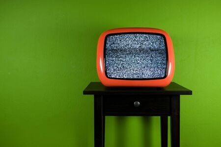 Red old retro television on green room Stock Photo