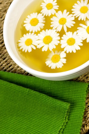 Bowl with herbal soothing chamomile tea photo
