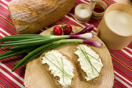 Healthy breakfast  cotage cheese, red onion and slice of bread photo