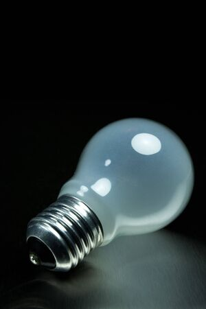Light bulb on metal black background Stock Photo - 4576123