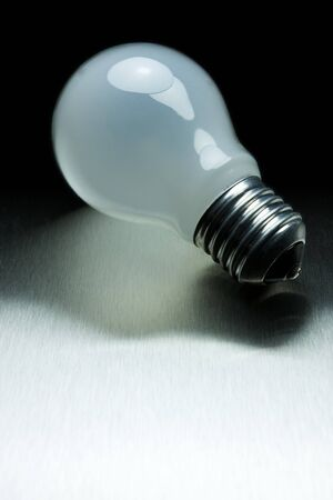 Light bulb on metal black background Stock Photo - 4576167