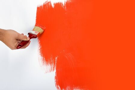Red painting with a paint brush