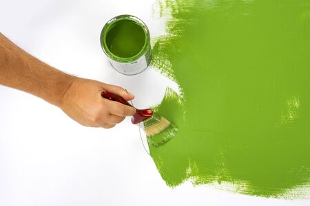 Green painting with a paint brush and paint can Stock Photo
