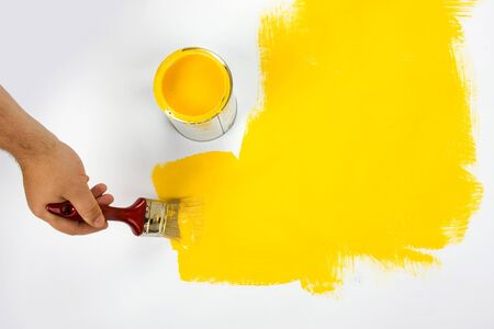 art work: Yellow painting with a paint brush and paint can