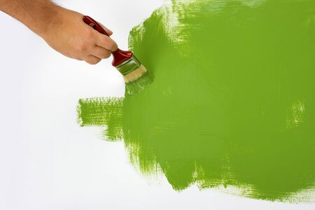 Green painting with a paint brush Stock Photo