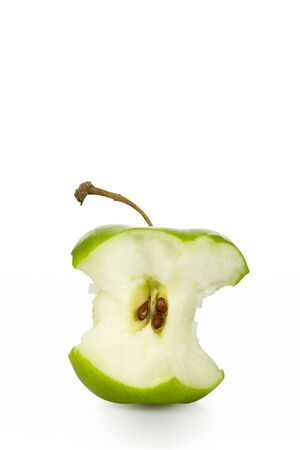 Green apple core over white Stock Photo - 4662886