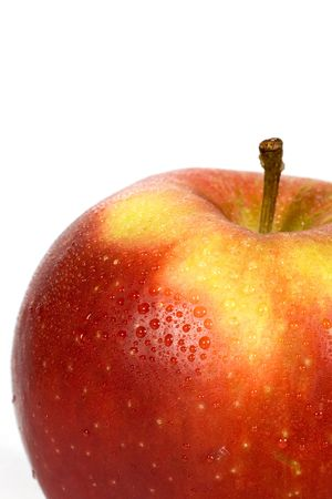 Close-up of Wet red apple on a white background photo