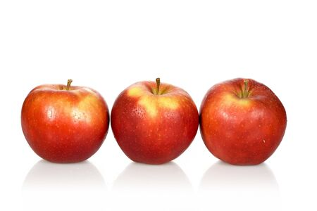 Three wet red apples on a white background photo