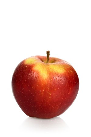 Wet red apple on a white background
