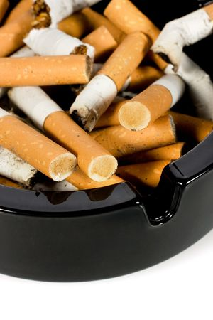 Close-up of cigarettes butts in ashtray photo