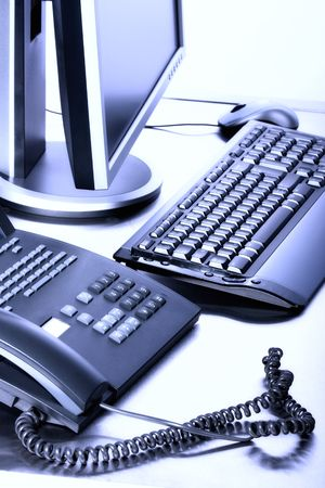 Business concept - keyboard, PC monitor, telephone - high key