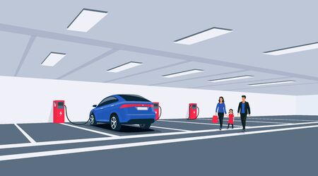 Electric car charging in underground basement garage store on charger station