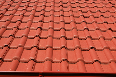 The roof is covered with red roofs of concrete tiles photo