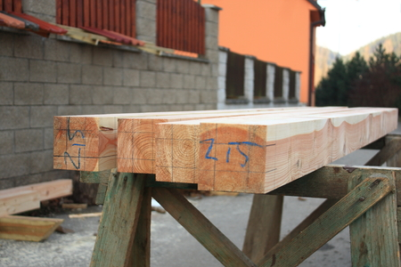 wooden joists: Planed larch beams ready for the working professional Stock Photo