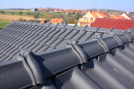 The roof is covered with black roofs of clay tiles photo