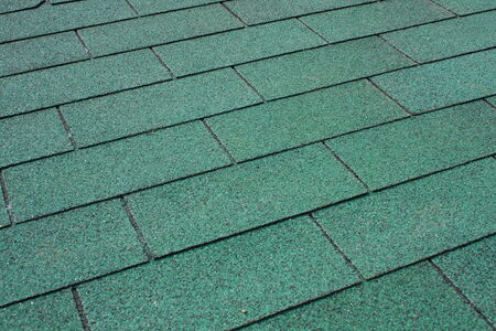 tar felt: Green asphalt shingle in the shape of a rectangle on the roof of the pergola