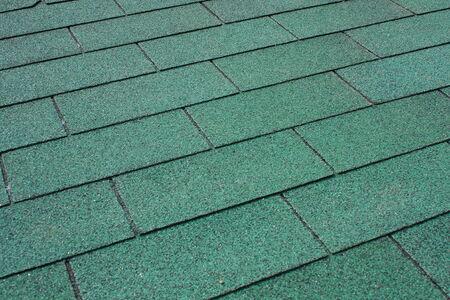 tar felt: Green asphalt shingle in the shape of a rectangle on the roof of the pergola