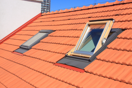 Two skylights fitted to the roof of burnt roofing Imagens